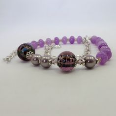 This gorgeous necklace features multi-coloured foil glass beads, pink crystals, purple glass, and purple alexandrite abacus beads on bright silver chain. Purple Glass, Alexandrite, Glass Beads, Jewelry Making, Beaded Bracelets, Chain, Crystals, Pink, Silver