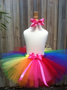 Rainbow tutu with pink bow.  Rainbow party tutu via Etsy