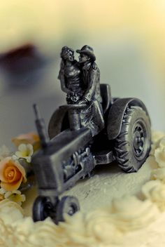 Tractor on a wedding cake...I would love this for our anniversary cake, Mr. 2g4fb would love this.