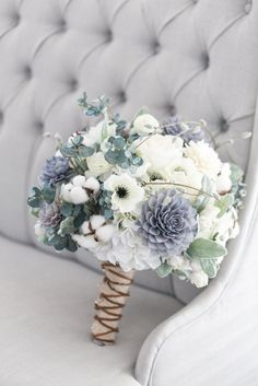 Our grey, navy and cream bouquet is a rustic beauty. This stunning bouquet has a great combination of flowers that work seamlessly with each other. With a mix of silk and wooden flowers this bouquet w