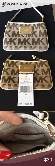 Michael Kors wristlet new with tags Michael kors new with tags signature line new with tags Michael Kors Bags Clutches & Wristlets