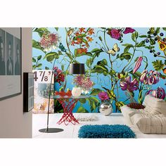 A host of happy florals blossom atop a dazzling blue backdrop for an eye-popping décor statement - Jardin Wall Mural - Komar Murals