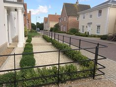 Beautiful, bespoke solid steel park fencing, gates & posts for East Anglia. Made by craftsmen, installed by experts. UK supply service. Call 01263 735656. Sloped Front Yard, Front Yard Decor, Modern Front Yard, Front Yard Fence, Front Yards, Front Path, Boxwood Landscaping, Landscaping Along Fence, Modern Landscaping