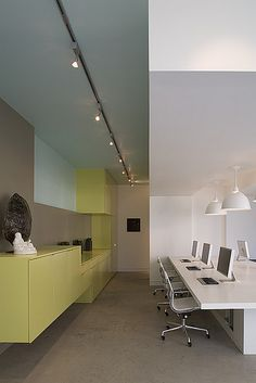 Love the color blocking wall ! Design Concepts~pops of color with clean  modern white desks.