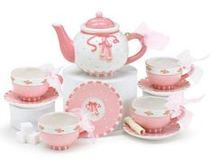 "Ballet shoes ceramic tea set with small raised floral designs. Set is hand painted. Teapot is 4 1/4'H X 1 1/2"" opening and holds 11 ounces. Teacup holds 4 ounces. Handwash only/FDA approved. Food Safe"