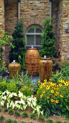 Make a hidden water reservoir for pots in the garden.When you pot up your flowers dangle a few 'wicks' (mop strings) out of the drainage holes. The wicks should be placed a few inches into the potting mix in your planter.  Water Feature for the Front, Back Yard