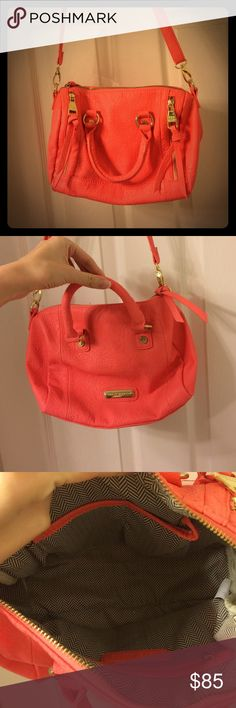Steve Madden Purse Coral color. Zippers on front are just decoration. Has short handles and a long strap. NWOT. Steve Madden Bags Satchels