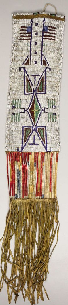 A Sioux pictorial beaded hide tobacco bag, circa 1890, sinew sewn and lane-stitched in various shades of glass seed beads, one side with a large forke...