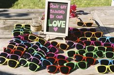 amazing ... I know people bring their own sunglasses to weddings, but how fun would it be to have a group pic of all your guests wearing funky shades!!?! I wish I had thought of this