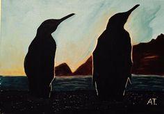 Pingüinos en una fría puesta de sol