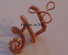 Coiled Copper Ear Cuff by DesignsOnYouLV on Etsy, $11.00