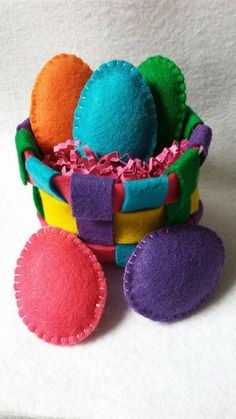 Munchkin and Bean: How to Make Felt Eggs-It'd be cute to put sensory items inside like beans or cellophane