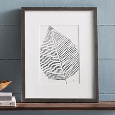A little shine adds so much to a room, so bring it in with our Silver Leaf Wall Art. This piece is a study in nature intricate simplicity. Modern    and so delicately pretty, with a single, artful silvery leaf matted and framed under glass, it a light, intricate accent that reminds us of the    beautiful changes of autumn, and life. Striking on its own, or used within a wall gallery.            Botanical silver leaf artwork is light, intricate                Simple, modern and delicately...
