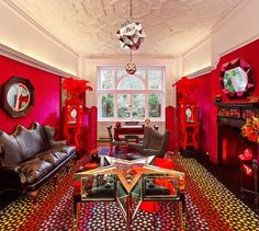 Color overload. One side of this room is a lovely green and the other is this sharp, glaring red.