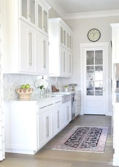 10 simple tips for styling the kitchen counters white modern farmhouse kitchen white shaker cabinets white carrar marble marble counters and herringbone backsplash kitchen countertop Modern Kitchen Counters, Kitchen Countertop Decor, Cabinets And Countertops, White Kitchen Cabinets, Shaker Cabinets, Marble Counters, Kitchen White, Kitchen Ideas, Kitchen Island