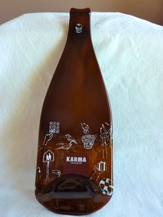 Slumped glass wine bottle cheese plate from Karma Winery