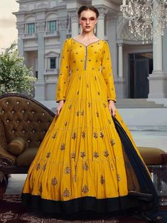 Classy yellow embroidered gown online at best shopping price. Shop this latest gown style for diwali celebration. This alluring style set comprises a georgette gown with matching net dupatta.