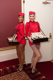 Old Fashioned Cigar Girls  www.EventKingsNY.com  (but passing out candy bars instead)