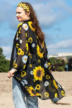 This beautiful and elegant long chiffon sunflower robe is perfect for any occasion. Wear with the tie for a cute and chic loungewear option. Or wear over your favourite dress as an open jacket for cooler autumn days or summer nights. You can even wear with it your favourite pair of jeans. The lightweight and flowy fabric adds the perfect bohemian touch to your outfit. Made with love in Montreal, Canada.