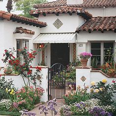 Spanish Mediterranean style - architectural detail, light stucco, tile roof, wood pillar and tile details