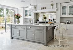 this contemporary grey kitchen is packed with appliances and features that are b… - luxury kitchen Open Plan Kitchen Living Room, Kitchen Dining Living, Home Decor Kitchen, Kitchen Interior, Space Kitchen, Family Kitchen, Grey Kitchens, Luxury Kitchens, Home Kitchens
