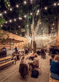 Summer Style - Outdoor Terrace at Night! Wonderful summer strings of lights, seating! Perfect for a party, wedding, shower!