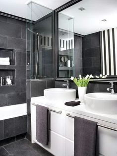 Gray bathroom. Love the sinks Modern, lots of drama here.  Because who knows when a girl needs drama in her bathroom.