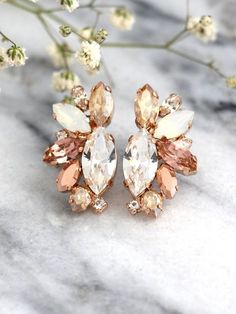 Rose Gold Champagne Cluster Earrings,Blush Bridal Earrings,Bridal Rose Gold Earrings,Bridesmaids Earrings,White Opal Champagne Studs Dazzling Cluster Crystal earrings feature a Marquise cut crystal set on a secure prong settings. The perfect shade for cocktail parties or to add a touch of color to your wedding ensemble Petite Delights is an Official SWAROVSKI® Branding Partner Our brand is legally licensed & authorized By Swarovski Company for high quality manufacturing. Matching Bra