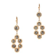 Adele Earrings  The Adele Earrings are all you need for an effortless undone elegance. Featuring light sapphire Swarovski crystals placed in decorative gold settings, these earrings make a serious splash on your lobes.