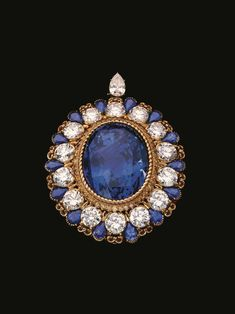 Alexandre Reza untreated Ceylon sapphire brooch featuring a 134 ct. large oval sapphire mounted on a gold clip set with 14 round diamonds 17 cts. t.w., a 1 ct. pear-shaped diamond, yellow diamonds, and 14 pear shaped sapphires 8 ct. t.w. from 1980 (Photos courtesy of Sotheby's