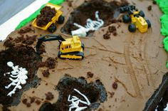 Boy's dinosaur and tractor cake