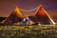 This gorgeous evening photo of our two giant hat tipis with festoon lighting was taken by @Christopher Terry Photography #TipiWedding #FestoonLighting #TipiHireMidlands