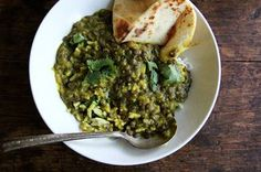 From Julia Turshen's <em>Small Victories</em>, these lentils come together in about 30 minutes, are deeply satisfying, and could be vegan if you leave out the yogurt. Naan is also really nice on the side here.   Re: lentils, I like to use a mix of French green lentils and red split lentils. It's faster if you use solely the red split lentils, but I love the texture offered by the French green ones when they're part of the mix. It's completely delicious both ways, so use what you have. Do…