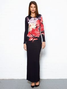 Jonathan Saunders Long Sleeve Peony Maxi Dress. This floor length printed maxi dress is the perfect all round piece. wear this Jonathan Saunders maxi during the day with boots and a leather jacket or dress it up at night into an elegant staple dress with jewellery and high pumps. This jersey dress features a printed front of graphic flowers in bright and muted tones of purple red and yellow with pop against the charcoal background.