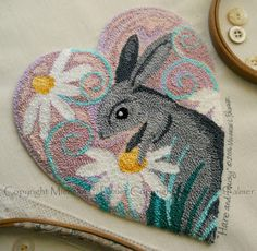 Michelle Palmer punch needle Gray Hare in the daisy patch. DMC floss cotton fibers Spring