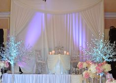 Sweetheart table on stage/backdrop/LED lights/crystal trees.