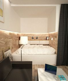 White wall cabinets with lighting beneath in a small narrow bedroom