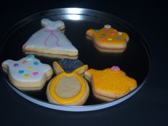 Here they are! The finished cookies from mixing to kneading then rolling and finally decorated! These are engagement rings,wedding dresses and teapots