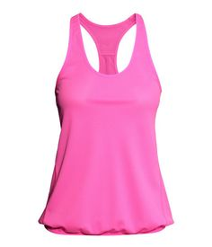 H&M US Sports Tank Top $15 : Description  Racerback sports tank top in fast-drying, functional fabric with narrow, elasticized trim at neckline, armholes, and hem. Loose fit. Details  Quick-dry, 100% polyester. Machine wash warm  Imported