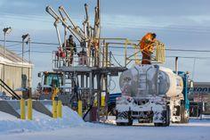 Fuelling a tanker, Moosonee, ON
