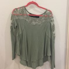 Long sleeve top Moss green long sleeve top with see through lace detail at the top and along the shoulders loose fitting sleeves and in great condition Free People Tops Tees - Long Sleeve