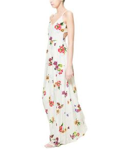 Floral Maxi dress from Zara  the cut outs in the back make it perfectly trendy for this summer season and a must wear piece to your next yacht party. wear with wedges of just flat sandals. available at Zara for $79.90