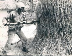 HUE, SOUTH VIETNAM: A member of the U.S. 9th Cavalry takes no chances while on patrol in the Hue area. There could be a Viet Cong guerrilla in the haystack. Just in case, he uses his bayonet.UPI PHOTO BY STEVE VAN METER 3/24/66