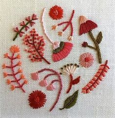 A lovely collection of flowers worked in shades of pink using a variety of stitches.
