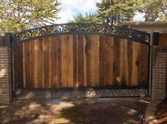 2148 Iron Wood Gates at www.ccoigateandfence.com Driveway Gate, Custom Design, Automatic Gate, Electric Gate, Wrought Iron, Wood