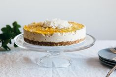 This mango cheesecake (a raw cheesecake) has a coconut center, macadamia crust and mango topping. It's tropical, delicious and gluten-free, vegan and paleo.