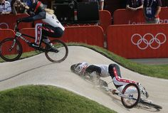 United States' Brooke Crain passes Alise Post who crashed in a BMX cycling women's semifinal run during the 2012 Summer Olympics in London, Friday, Aug. Carmelita Jeter, Olympic Cycling, Allyson Felix, 2012 Summer Olympics, Bmx Racing, Star Wars, Summer Games, Sports Training, World Of Sports