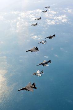 Flight formation of ROKAF fighters. F-15K Slam Eagle, KF-16 Falcon, F-4 Phantom photograph by SMS Kim, Kwon Ryul