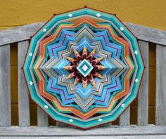 A mandala of Blue Horizons, big dreams, and following your star. Ive been making yarn and stick mandalas on and off since the 1960s, after seeing