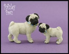 Two customized pugs were made using Schleich pvc models...